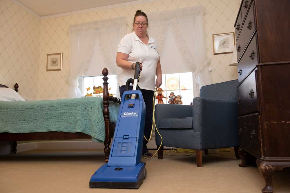 Vacuuming a resident's room