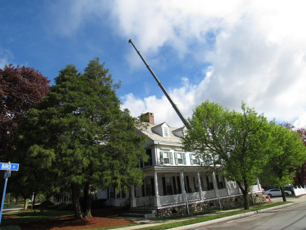 unusual site of crane looming over the Doolittle Home