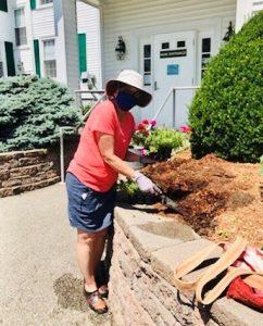 Beth planting flowers